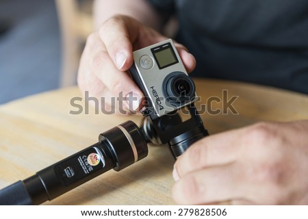 ISTANBUL, TURKEY - MAY 19 ,2015: Gopro action camera in hand.Shot of GoPro Hero 4 Black.It is a compact, lightweight personal camera manufactured by GoPro Inc. - stock photo