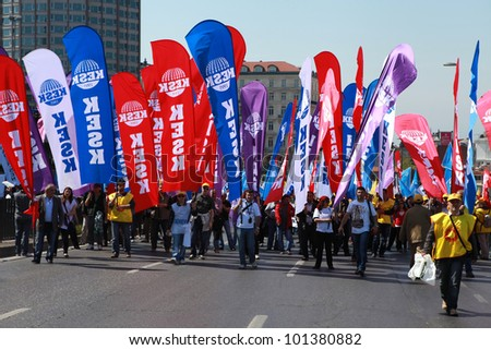 ISTANBUL, TURKEY - MAY 1: International Workers Day. Workers and socialist group walks on Sisli and Taxim on May 1, 2012 in Istanbul, Turkey
