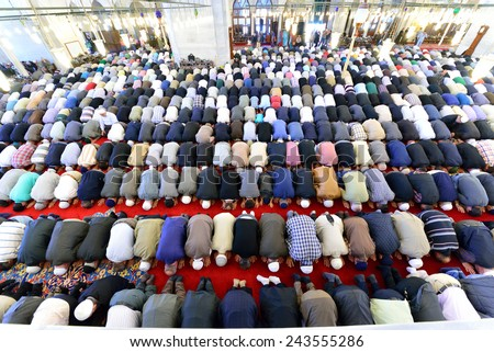 ISTANBUL, TURKEY - MAY 17: noon prayer in congregation male Muslims Fatih Mosque on May 17, 2014 in Istanbul, Turkey. Prayer is a prayer that Muslims do five times each day. - stock photo