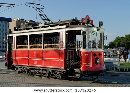 ISTANBUL, TURKEY - MAY 20: Old-fashioned red tram at the street Istanbul on May 20, 2013. Nostalgic tram is the heritage tramway system. It was re-established in 1990 and gained much popularity.