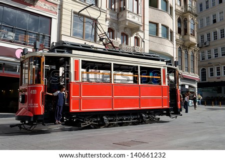 ISTANBUL, TURKEY - MAY 20: Old-fashioned red tram at the street Istanbul on May 20, 2013. Nostalgic tram is the heritage tramway system. It was re-established in 1990 and gained much popularity. - stock photo