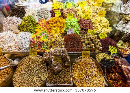 ISTANBUL TURKEY - MAY 25 2014: Shopping arcade with spices, nuts and sweets in the Spice Bazaar (Egyptian Bazaar)  in Istanbul, Turkey. Spice Bazaar is the oldest bazaar in Istanbul. - stock photo