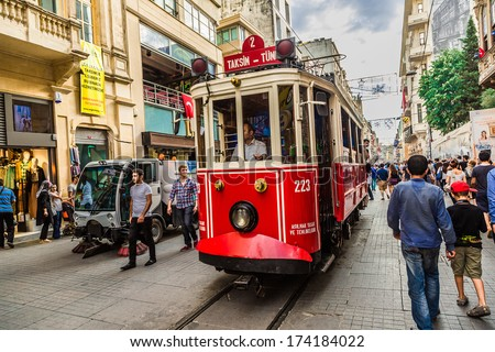 ISTANBUL, TURKEY - MAY 14 : Taksim Istiklal Street at eventide on May 14, 2013 in Istanbul, Turkey. Taksim Istiklal Street is a popular destination in Istanbul. - stock photo