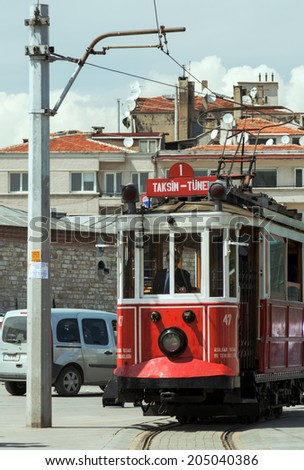 ISTANBUL, TURKEY - MAY 05 : Taksim Istiklal Street on May 05, 2014 in Istanbul, Turkey. The Beyoglu traditional red vintage tram is a landmark of Istanbul.