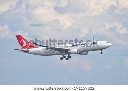 ISTANBUL, TURKEY - MAY 2, 2014: Turkish Airlines Airbus A330 landing at Istanbul Ataturk Airport.  This aircraft, TC-JNA, was delivered in 2005 and it is the first A330 in the Turkish Airlines fleet. - stock photo