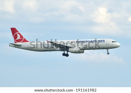 ISTANBUL, TURKEY - MAY 2, 2014: Turkish Airlines Airbus A321 landing at Istanbul Ataturk Airport.  This aircraft, TC-JRS, flying for the Turkish flag carrier since 2011. - stock photo