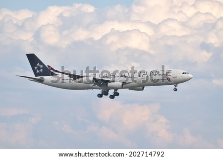 ISTANBUL, TURKEY - MAY 2, 2014: Turkish Airlines Airbus A340 landing at Istanbul Ataturk Airport.  Turkish flag carrier airline is member of Star Alliance since 2008. - stock photo