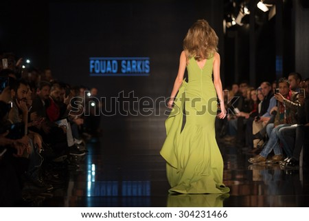 ISTANBUL, TURKEY - NOVEMBER 22, 2014: A model showcases one of the latest creations by Fouad Sarkis in Fashionist fashion fair