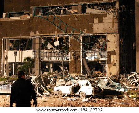 ISTANBUL, TURKEY - NOVEMBER 20: Demolished building after terror attack and bomb explosion in Levent HSBC Bank on November 20, 2003 in Istanbul, Turkey. Killing thirty people and wounding 400 others. - stock photo