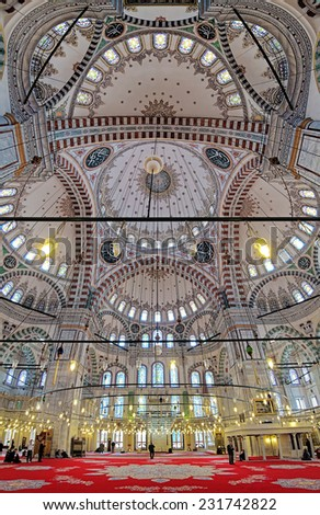 ISTANBUL, TURKEY - NOVEMBER 13, 2014: Interior of Fatih Mosque (Mosque of sultan Mehmed the Conqueror). The mosque was built in 1463-1470, destroyed by an earthquake in 1766 and rebuilt in 1771. - stock photo