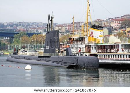 ISTANBUL, TURKEY - NOVEMBER 12, 2014: Submarine TCG Ulucalireis S-338 (former USS Thornback SS-418) in the Rahmi M. Koc Museum. The Rahmi M. Koc industrial museum was opened on December 13, 1994. - stock photo