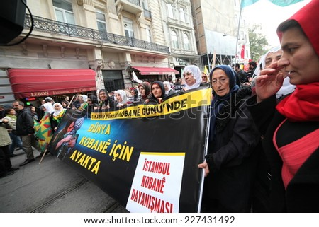 ISTANBUL, TURKEY-NOVEMBER 1: Thousands of people march in Turkeys province of Istanbul in a peaceful support rally for Syrian city under ISIL fire on November 1, 2014 in Istanbul, Turkey. - stock photo