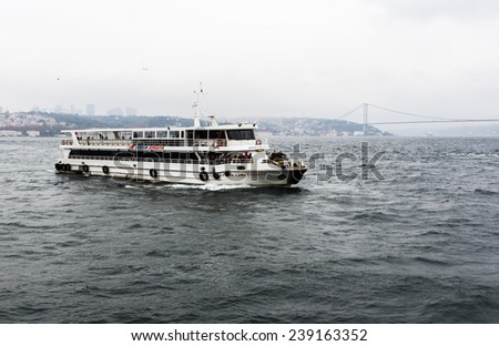 Istanbul, Turkey - November 14, 2014: Tourists are participating on a boat trip at the Bosphorus.