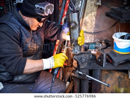 Istanbul,Turkey - November 19,2016 : Welder working in metal workshop - hard-working man