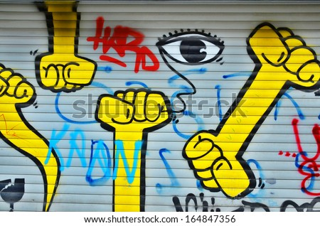 ISTANBUL TURKEY OCT 29: Graffiti captured on a wall on Oct 29 2013 in Istanbul Turkey .The walls of the Turkish city enlivened by murals, whimsical painted figures, graffiti and stencils - stock photo
