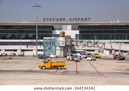 Istanbul, Turkey - October 11, 2009: Airport workers and cars on Ataturk international Airport - stock photo