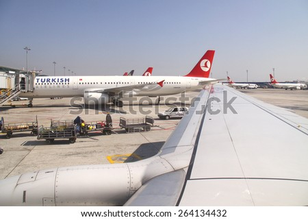 Istanbul, Turkey - October 11, 2009: Docked airplanes in Ataturk international airport.
