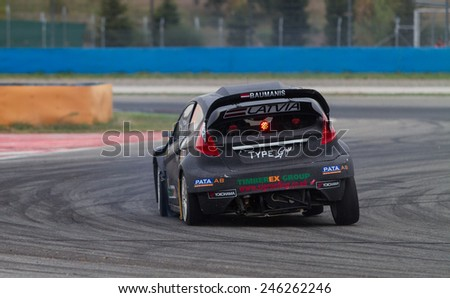 ISTANBUL, TURKEY - OCTOBER 12, 2014: Janis Baumanis drives RX Lites of Set Promotion Team in FIA World Rallycross Championship. - stock photo