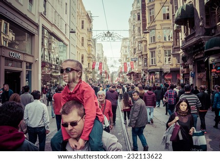 ISTANBUL, TURKEY - OCTOBER 25, 2014 : People walking on Taksim Istiklal Street , a popular tourist destination in Istanbul. Toned image