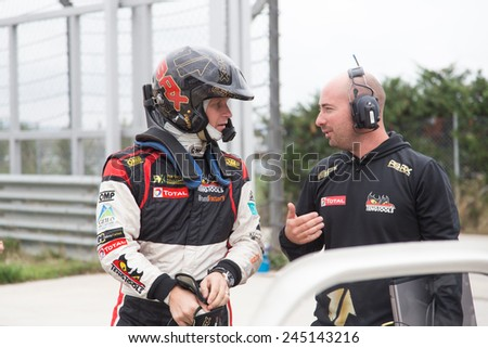 ISTANBUL, TURKEY - OCTOBER 11, 2014: Petter Solberg talk with his mechanic before FIA World Rallycross Championship. - stock photo
