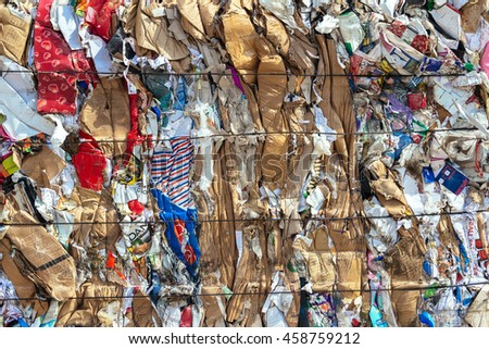 Istanbul, Turkey-September 4, 2015: Collected cardboard has been pressed and tied up for recycling.