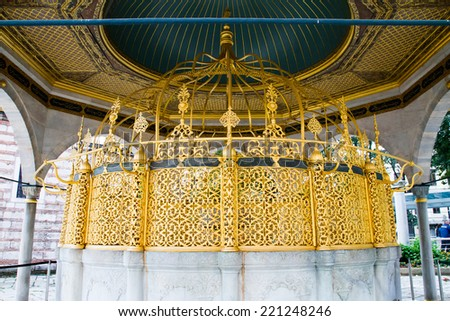 ISTANBUL, TURKEY - SEPTEMBER 23: Fountain Hagia Sophia former Greek Orthodox patriarchal basilica (church), later an imperial mosque, and now a museum on September 23, 2014 in Istanbul, Turkey - stock photo