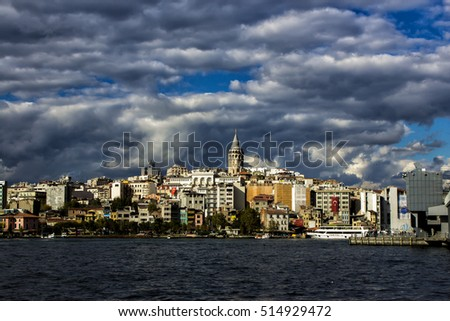 ISTANBUL, TURKEY - September 24, 2016: Galata Tower from Eminonu, Galata Bridge with sea and house view