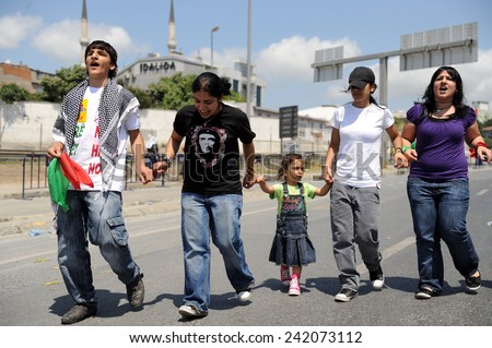ISTANBUL,TURKEY - SEPTEMBER  01: Kurds, celebrating the World Peace Day. Some protesters wore T-shirts that peace tick  on September  01, 2009 in Istanbul, Turkey.