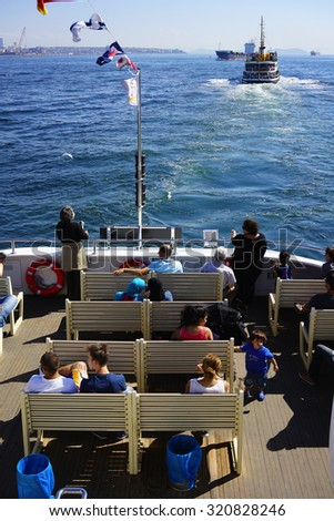 ISTANBUL, TURKEY - SEPTEMBER 25, 2015:People travel on a ferry from Eminonu to Kadikoy in Istanbul, Turkey - stock photo