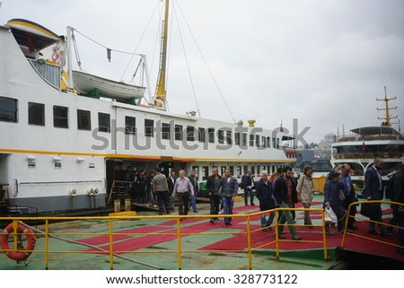 ISTANBUL, TURKEY - SEPTEMBER 30, 2015: Unidentified tourists walking Karakoy pier, on JSEPTEMBER 30, 2015 in Istanbul, Turkey. Approximately 150,000 passengers use ferryboats daily in Istanbul. - stock photo