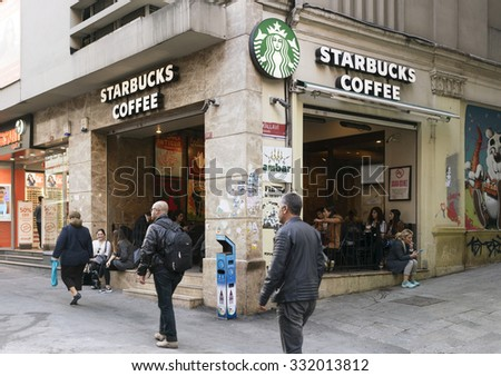 ISTANBUL, URKEY -OCTOBER 19,2015:Starbucks coffeehouse in istanbul on OCTOBER 19,2015 in Istanbul. Starbucks is the largest coffeehouse company in the world, with almost 20,000 stores in 58 countries. - stock photo