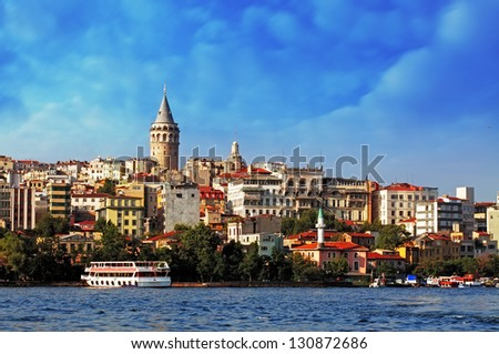 Istanbul with dramatic clouds - Galata district, Turkey - stock photo