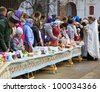 ISTRA, RUSSIA - APRIL 14, 2012: Easter cakes and eggs consecration in the  New Jerusalem Monastery on April 14, 2012 in Istra, Moscow oblast, Russia. - stock photo