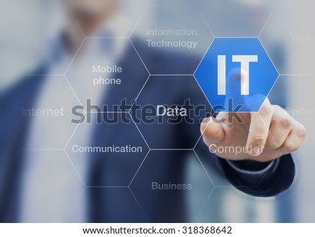 IT consultant presenting tag cloud about information technology - stock photo
