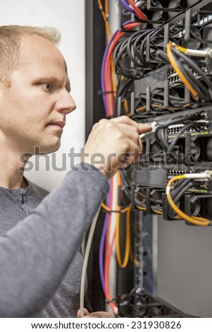 IT consultant working with network switches - stock photo