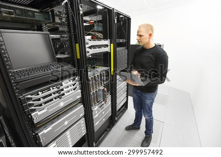 It engineer maintains servers in datacenter - stock photo
