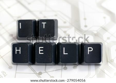 IT HELP - Helpdesk - Black Keyboard keys IT HELP on White Circuit Board Background - stock photo