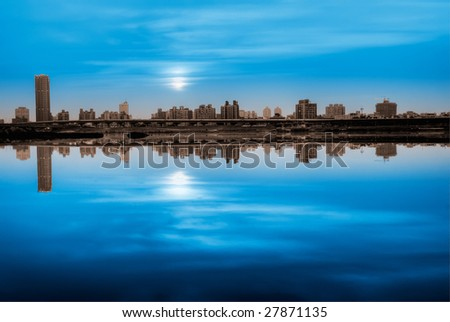 It is a city landscape of blue night. - stock photo