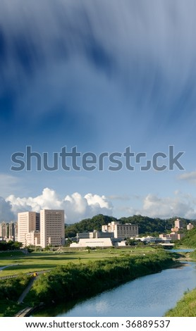 It is a cityscape photo of house near a river.