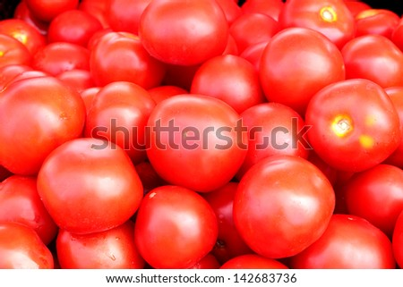 It is a lot of red, ripe tomatoes. Horizontal photo.