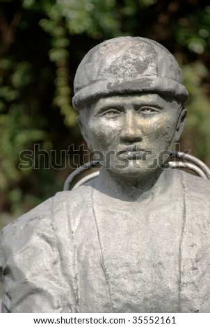 It is a man of Atayal tribe stone carving portrait in Taiwan.