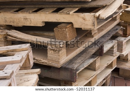 it is a shot of piles of wooden pallets - stock photo