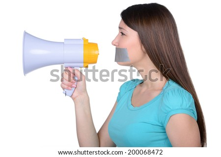 It is better to be silent. Upset girl with self-adhesive tape over her mouth, trying to shout in a megaphone