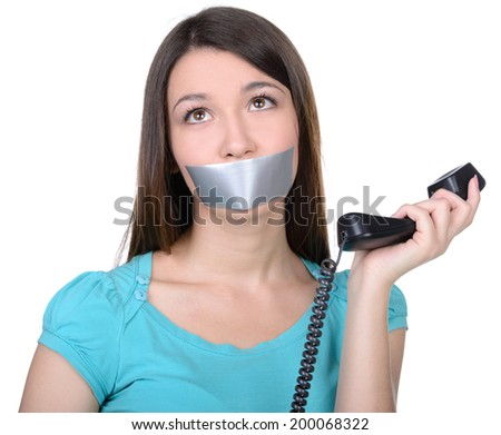 It is better to be silent. Upset girl with self-adhesive tape over her mouth, trying to talk on the phone - stock photo