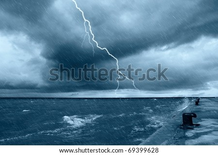 it is raining on the pier - stock photo