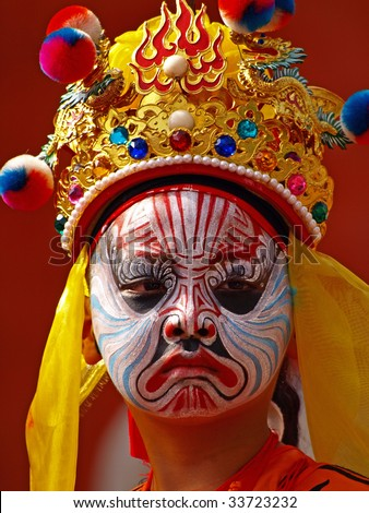 """It is the facial mask-like makeup of a young """"Eight Generals"""" which is a very important holy character in Taiwanese religion. - stock photo"""