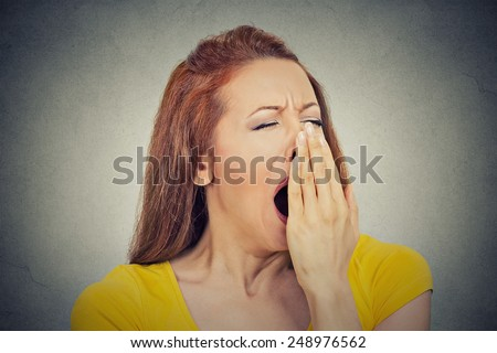 It is too early for meeting. Closeup portrait headshot sleepy young woman with wide open mouth yawning eyes closed looking bored isolated grey wall background. Face expression emotion body language - stock photo