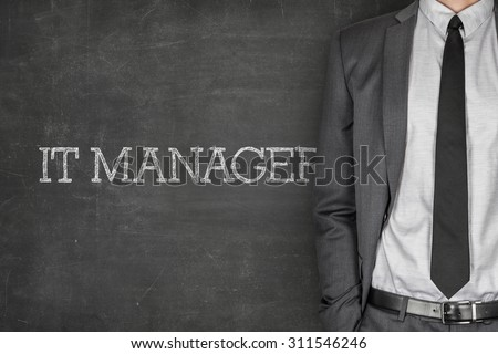 IT manager on blackboard with businessman in a suit on side