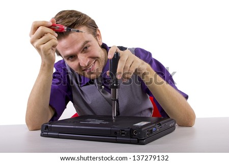 IT Professional.  young man fixing a broken laptop and isolated on a white background.