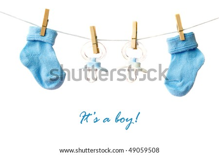 It's a boy! Baby socks and pacifiers on the clothesline - stock photo